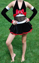 Photo: To buy (ADC-Soph. Ladies) reference name of costume, size, qty needed and copy/past photo to Pam@Act2DanceCostumes.com   Price: $100.00  QTY(1)  (1) Med Child   You dont want to miss out out on this wonderful Semi Custom Made costume by Pumpers. Black valvet top, skirt & gloves are trimmed in white & red stain. Layer of tule under skirt just peeks out for a great layed look.   2 gross Red & Clear Swar. rhinestones cover all stain pieces (bows, sashes, skirt and gloves  7 day returns same condition! Paypal/Credit/Western Union accepted.  US shipping $10 plus 3% paypal fee for costumes over $100  Contact for world wide shipping quote. Thanks!  SA