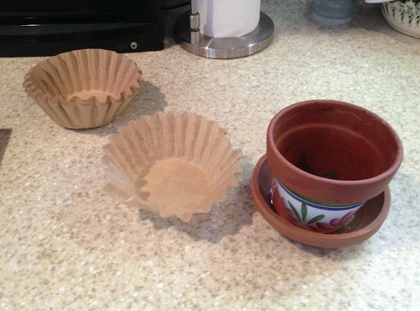 """In a small clay pot, place a """"basket"""" coffee filter. This keeps the dirt..."""