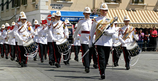 Gibraltar-drum-corps - British pageantry on display as the Corps of Drums of the Royal Gibraltar Regiment passes by the Convent.