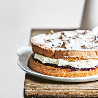 Jam And Cream-filled Sponge Cake With Rose Geranium Leaves.