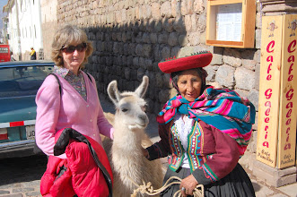 "Photo: One of the first things Edgar told us about Peru was ""if you don't work, you don't eat."" This woman and her llama make a living by posing for photos. We were happy to oblige."