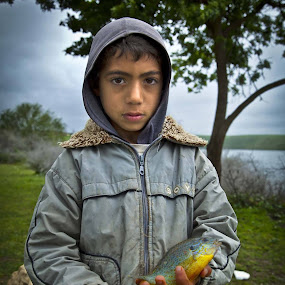 Child and fish by Abdulmagid alfrgany Photograph - Babies & Children Child Portraits