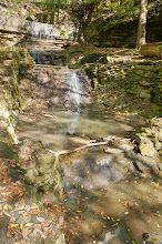 Photo: As can be seen, Hidden Falls has been much altered by human development, not least of which is that the creek which feeds it has been confined underground. The terminus of the  conduit which contains it can be seen at the top of this photo.