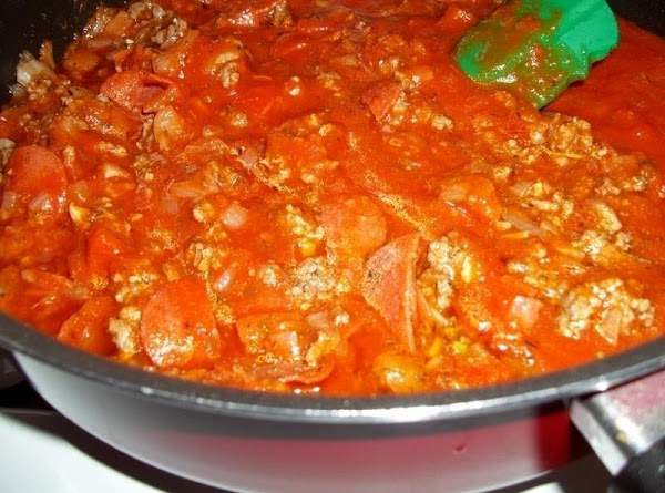 Return the meat mixture to the skillet, add sauce. Simmer till heated through.