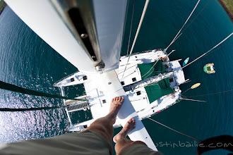 Photo: Self portrait from mast of catamaran while sailing in the Galapagos Islands, Ecuador.