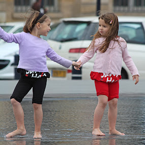 Twins playing in a Bordeaux water park by Pam Blackstone - Babies & Children Children Candids ( water, little girls, girls, water park, twins,  )