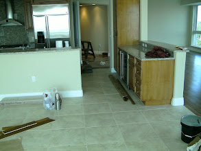 Photo: finished tile installation along with hardwood floors