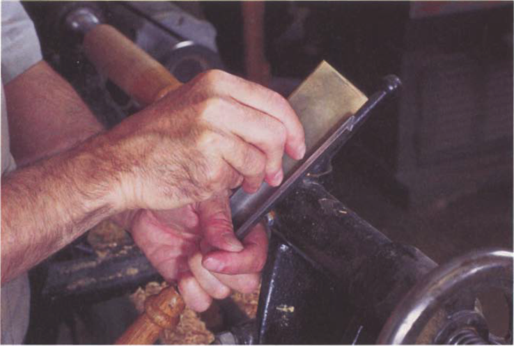 For most tools, it is typically easiest to hold the tool in one hand and the stone in the other. View the operation from the side so that you can be sure that the stone is contacting at the edge and at the heel.