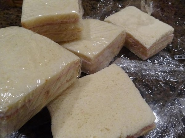 Lay out two pieces of bread and spread desired amount of mayo on each...