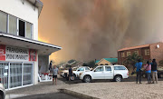 Smoke engulfs the coastal village of Franskraal, near Gansbaai on Friday.