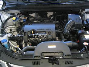 Photo: Motorraum mit Valve Saver und neuem Gasrail