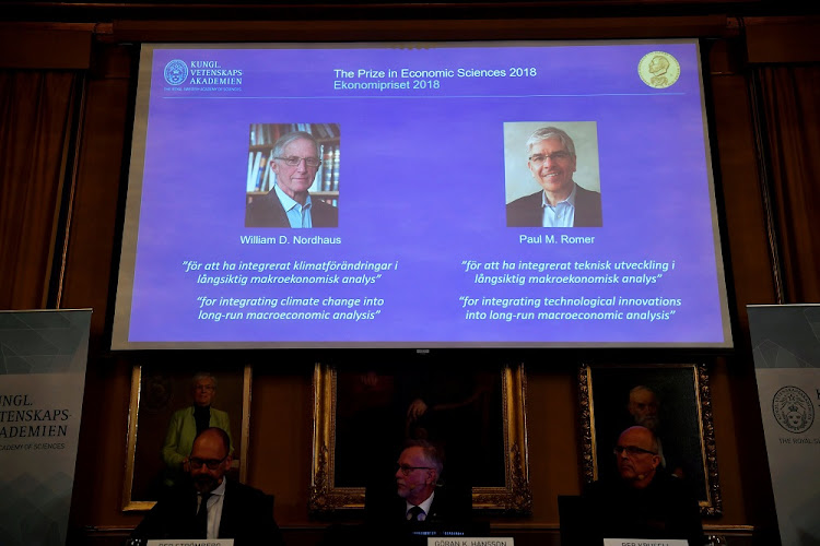 Per Stromberg, Goran K. Hansson and Per Krusell announce the laureates of the Nobel Prize in Economics during a press conference at the The Royal Swedish Academy of Sciences in Stockholm, Sweden, October 8 2018. The prize is divided between William D. Nordhaus and Paul M. Romer. Picture: HENRIK MONTGOMERY/TT NEWS AGENDA/VIA REUTERS