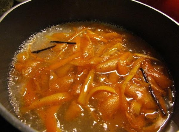 Place your orange sliced back into your pan and bring to a boil. Reduce temperature...