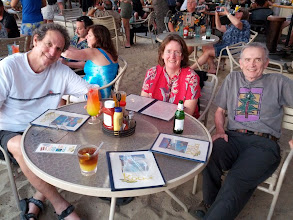 Photo: Howard, Laurel, Randy at dinner at a restaurant (Canoe Club?) on the downtown Kona waterfront. We heard lovely music by a young man Devon knew as a kid