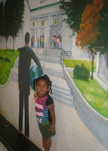 Photo: Kaleya in front of the mural of the high school that we were at