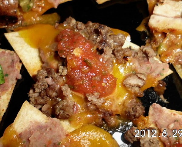 BEEF AND BEAN nacho's.  Spread tortilla chip with unfried beans, add cheese and...