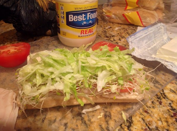 Take a handful of shredded lettuce and place on bean sprouts.