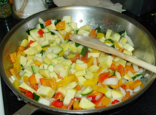 In a medium to large skillet, melt the butter and saute the onion, peppers,...