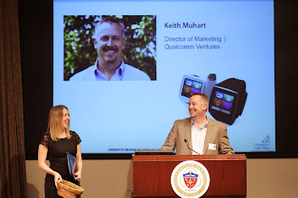 Photo: Keith Muhart, Qualcomm Ventures, gifts 8 Toq smartwatches to the Social Innovation Challenge finalists