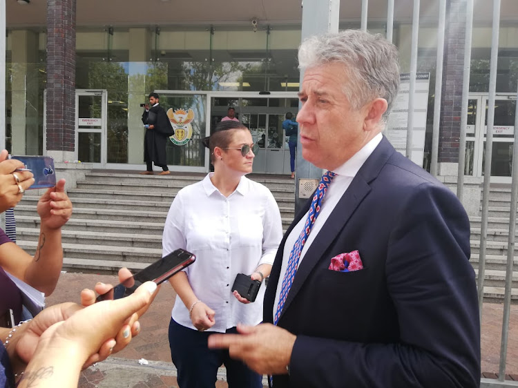 Defence lawyer William Booth and Sans Souci Girls' High School teacher Clarissa Venter outside the Wynberg Magistrate's Court, where Venter is facing charges of common assault after she allegedly slapped a pupil.