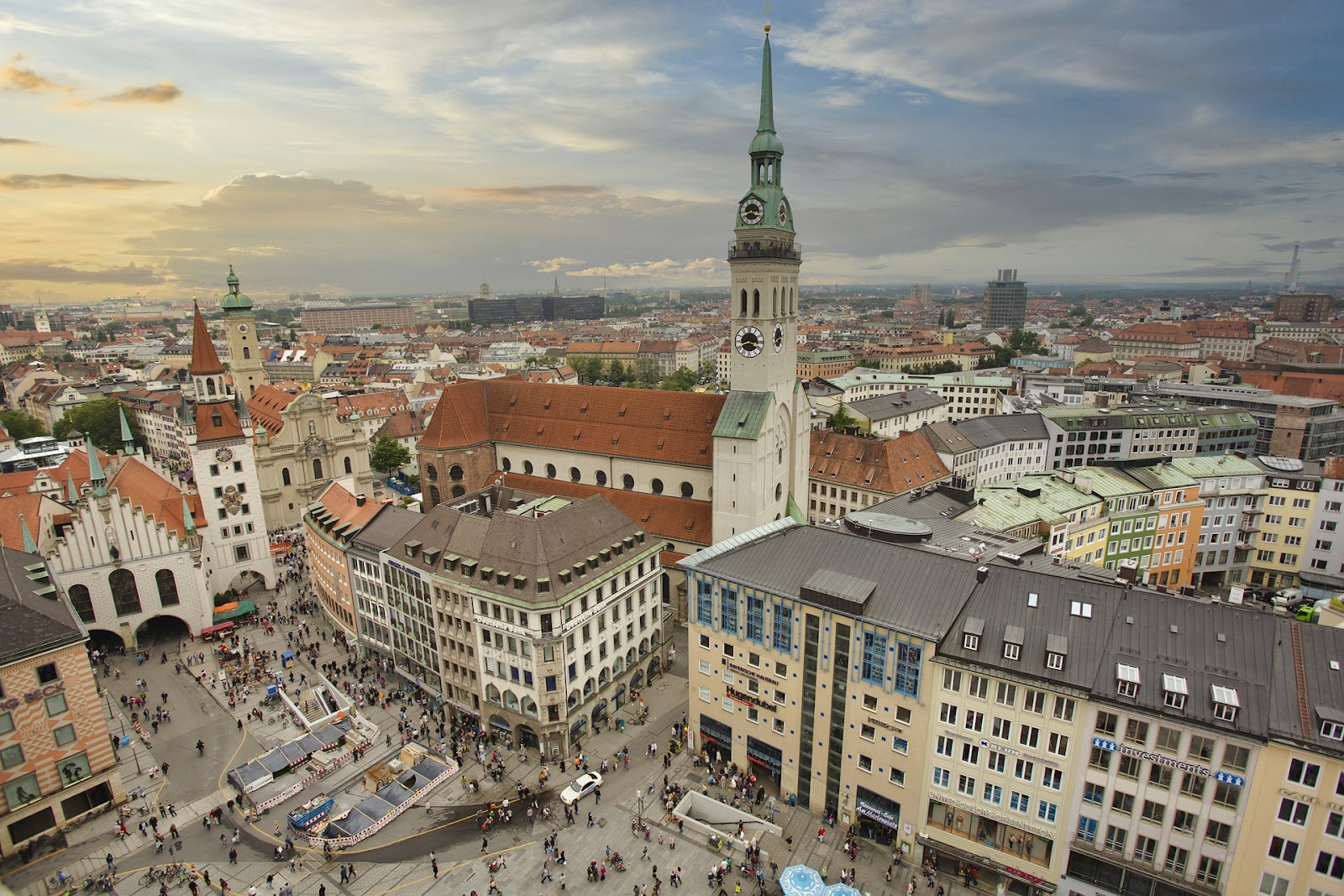 munich old town medieval church seen from above next to traditional bavarian buildings on a cloudy day germany. Enjoy the best day trips in Munich with Rentalmoose
