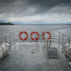 Stern by John Carr - Transportation Boats ( red, sky, gray, rings, ship, stern, water, boat, life belts, grey,  )