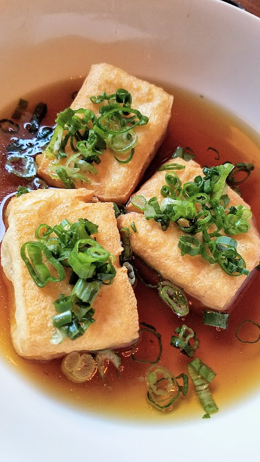 Shigezo Agedashi Tofu appetizer with fried tofu, mochi, ginger, grated daikon, shishito pepper