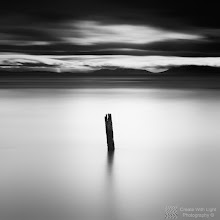 """Photo: """"One"""" - http://www.createwithlightphotography.com  This is a 58 second exposure of an old piling in the Strait of Georgia in Vancouver.  I used a 10 and a 3 stop ND filter, and stacked a 3 stop soft grad ND filter, to get the right level of contrast in the the clouds, water and around the piling.  This is the second image in my new series of numbered pilings.  The clouds and light were perfect that day and created a layer of light around the pilings around high tide.  This is my contribution to the #LongExposureThursday theme, kindly curated by +Francesco Gola and +Le Quoc , the #ThirstyThursday theme, kindly curated by +Giuseppe Basile and +Mark Esguerra , the #FineArtPls theme, curated by the lovely +Marina Chen and +Fineao Fang , the #BWFineArtLE theme, curated by the amazing Mr +Joel Tjintjelaar and +Black and White Fine Art Photography Gallery , #SquaresAreSassy curated by my great friend +Nathan Wirth , my wonderful friend, muse and supporter +dene' miles and finally the #PlusPhotoExtract theme, run by the awesome +Jarek Klimek  All thoughts and comments welcome.  Please visit my website to view more of my images: http://www.createwithlightphotography.com  #PlusPhotoExtract #GrantMurray #CreateWithLightPhotography #BWFineArtLE #FineArtPls"""