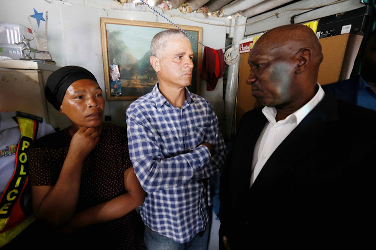 Brionay Julies' distraught parents, Gail and John Julies, talk to Police Minister Bheki Cele in their home in Bokmakierie.