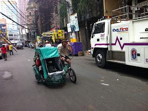 "Photo: Jason pedals a ""pedi cab"""