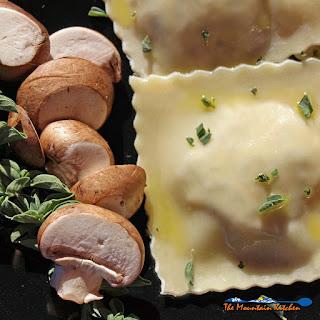 Mushroom and Sun-Dried Tomato Ravioli With Lemon Butter Sauce.