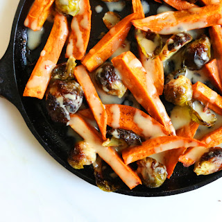 Roasted Sweet Potato and Brussel Sprouts with Maple Tahini Dressing