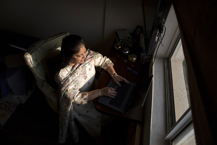 Teena Likhari, an operations manager at WNS Global Services, working from home in Gurgaon, Haryana, India, on November 20 2020. Picture: BLOOMBERG/ANINDITO MUKHERJEE