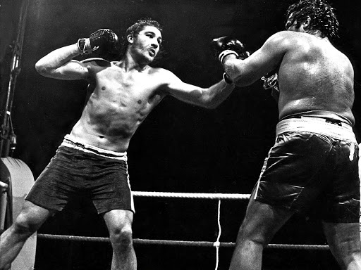 Gerrie Coetzee, left, throws a punch at Mike Schutte during their dirty fight in 1976.