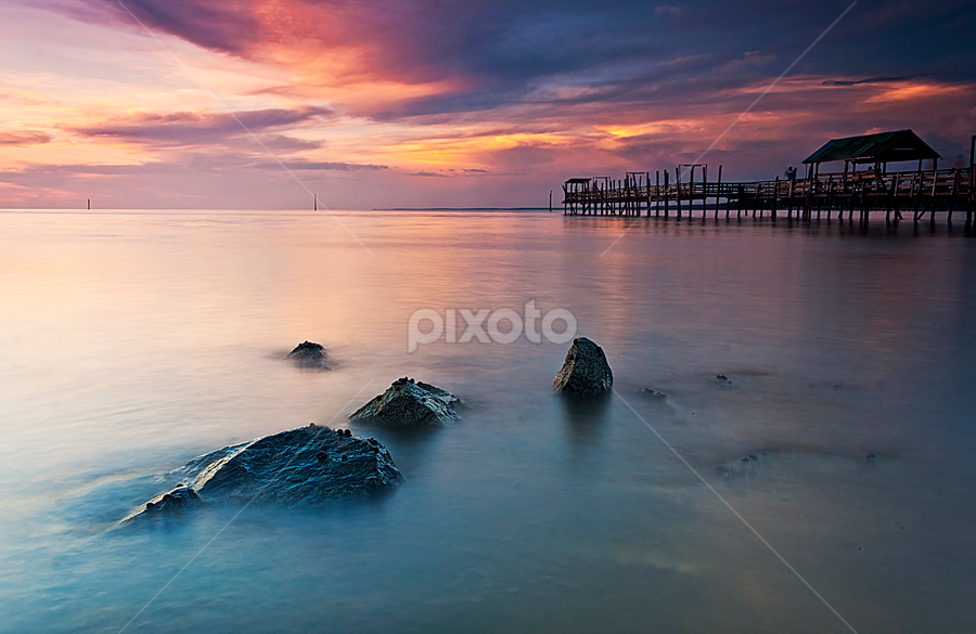 Sunset at Pontian, Johore by Macbrian Mun - Landscapes Waterscapes ( waterscape, colors, sea, malaysia, jetty, seascape, landscape, sky, johore, sunset, background, rocks, evening )