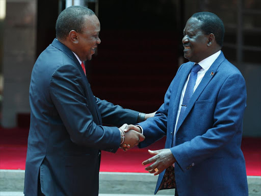 President Uhuru Kenyatta and Opposition leader Raila Odinga on the footsteps of Harambee House on March 9, 2018.