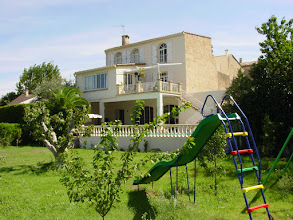 Photo: The Back Half of the House taken from the slide and swings ten years ago. Slide now gone. The garden here is now a thriving orchard, with peaches, plums, apricots, figs, grapes, apples and pears ready to eat when ripe....