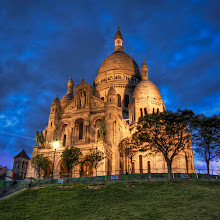 Photo: La Basilique du Sacre Coeur de Montmatre  This is a famous basilica in Paris.  It sits high on a hill and is beautifully lit in the evening.  This is the birthplace of the Jesuits back in 1534.  That is only interesting to me because I was a Jesuit student myself back in the day.  You would think that would mean that I would be allowed to come inside to take all the photos I want with a special key that everyone gets upon graduation.  But I had no such key so I was forced to stay on the perimeter with all the other heathens.   from the blog at www.stuckincustoms.com