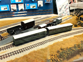 Photo: 007 Peco also attended the show with a display of their 009 products, including the recently introduced ready to run goods vehicles and the eagerly awaited Lynton & Barnstaple passenger coaches .