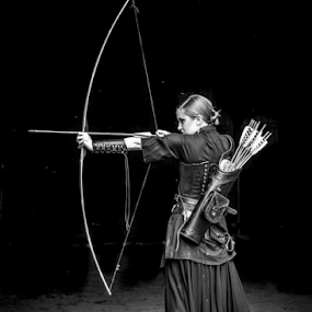 Aim to Kill by Myra Brizendine Wilson - People Portraits of Women ( female, clothing, bow & arrows, archery, and fashion, costume, renaissance costume, bow, stables,  )