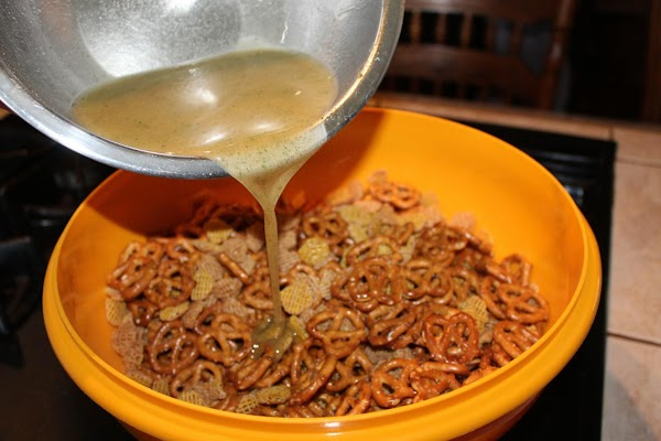 Pour over pretzels and cereal in a large bowl that you can cover and...