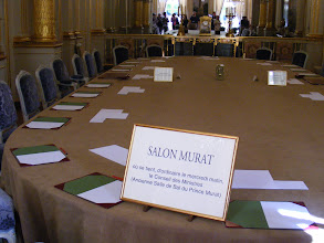 Photo: The salon Murat has been home to the weekly (Wednesday morning) meeting of the Council of Ministers since Pompidou. The President and Prime Minister sit on opposite sides of the table, across from the small brass box - which is a clock, so that each may see the time simultaneously. Also, at dinners for foreign heads of state, honored guests are presented in this room. Visible at the rear, with a clock on top, is a console table dating from 1819, with porcelain decor from the Manufacture Nationale de Sèvres - which (like the Gobelins) has a royal history, but is now state operated.