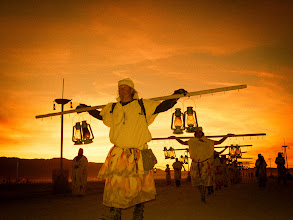 Photo: Every evening, a group of lamplighters walk through Black Rock City, hanging lanterns atop tall poles to keep the pathways lit for other travelers. - from Trey Ratcliff at www.stuckincustoms.com