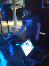 Photo: Andy Bagley DJing at Upgrade. Photo by Dennis Remmer.