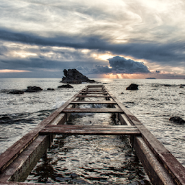 Pier and cloud  by Gianluca Presto - Buildings & Architecture Bridges & Suspended Structures ( cloud, sky, pier, rocks, waterscape, nature, tuscany, sunset, water, sea, italy )