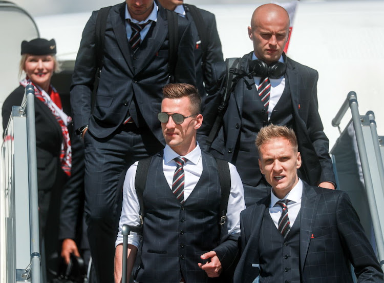 Arkadiusz Milik, Lukasz Teodorczyk and Michal Pazdan (background) of the Polish men's national soccer team arrive in Russia to take part in the 2018 FIFA World Cup.