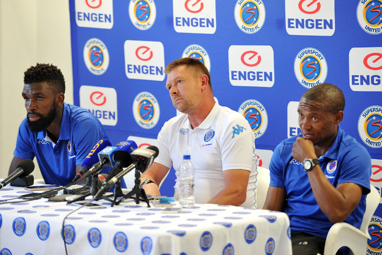SuperSport United head coach Eric Tinkler (C) is flanked by defender Tefu Mashamaite (L) and winger Thuso Phala (R) during the CAF Confederations Cup final press conference at Megawatt Park, Johannesburg on 15 November 2017.