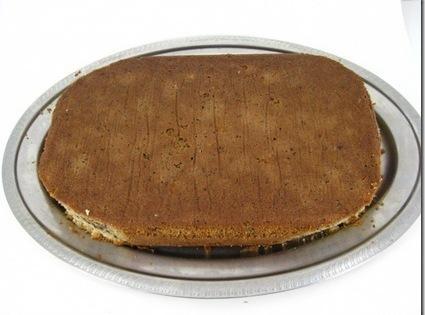 trimmed corners off cake on platter