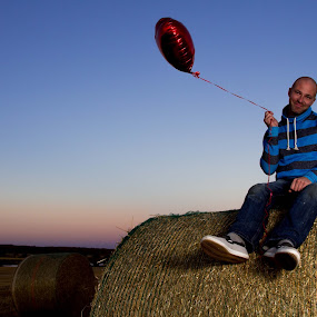 I love my Baloon by Glenn Angel - People Portraits of Men ( farm, sunset, happy, hay, balloon,  )