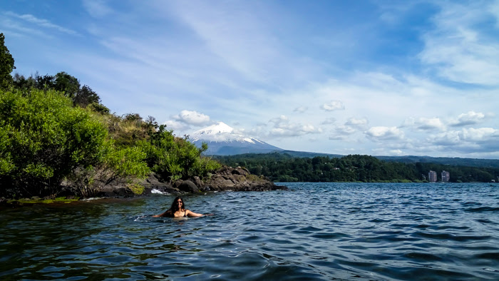 swimming in the lake villarrica in front of the volcano villarrica in pucon chile